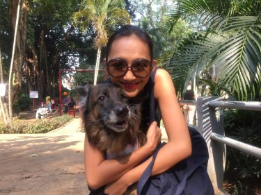 A member of the Dog Meat-Free Indonesia coalition with a rescued dog.