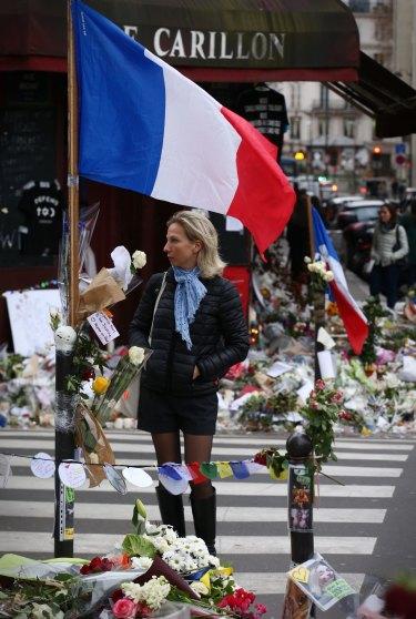 Memorials at Le Carillon bar and Le Petite Cambodge restaurant in Paris.