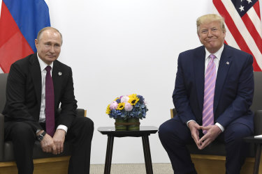 US President Donald Trump, right, meets with Russian President Vladimir Putin during a bilateral meeting on the sidelines of the G-20 summit in Osaka.