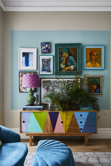 """""""Many of our paintings are by the artist John Benn – he and his wife Sara  were family friends,"""" says Robyn. The console is from Family Love Tree."""