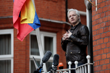Julian Assange speaks to the media from the balcony of the Ecuadorian embassy in May 2017.