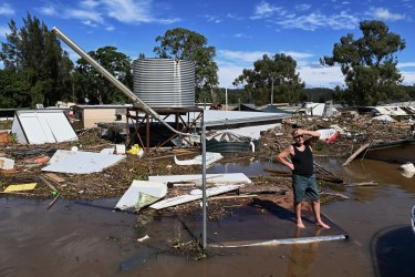 Brad McCutcheon, a resident of St George Caravan Park, surveys the scene during flooding of the Hawkesbury River near Sydney in March 2021.