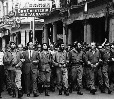In this March 5, 1960 file photo, Cuban leaders walk arm-in-arm at the head of the funeral procession for the victims of the La Coubre explosion, blamed by the Cuban government on a US bomb attack on the Cuban ship La Coubre in the harbour of Havana.
