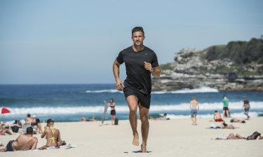 Ready to run: City2Surf ambassador Tim Robards at Bondi Beach.