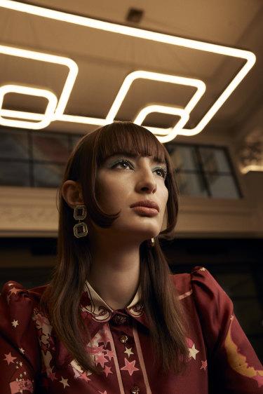 """Bela wears Zimmermann top, $650, and Valére """"Jenny"""" earrings, $280."""