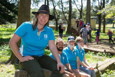 Sam Crosby in the Wild Play garden with other nature play educators.