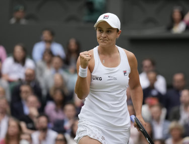 Ash Barty celebrates after winning the Wimbledon final.