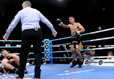 Tim Tszyu knocks down Jeff Horn during round 3.