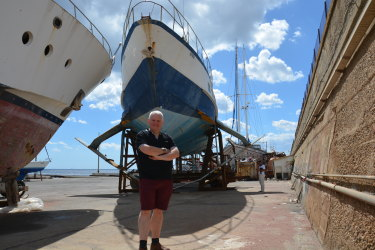 Andrew Heighway with the old Sydney hydrofoil (the Curl Curl) being restored in Messina, Italy where it was built in 1972.