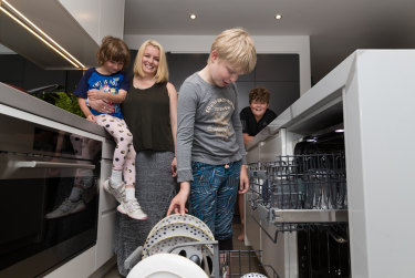 Belinda Beck pays her children Asher, Zane and Indy to do various household chores.