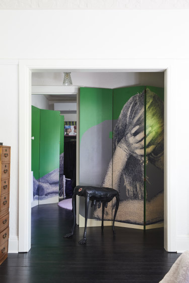 Upstairs, two bedrooms have been converted into large dressing rooms which flank the main bedroom. A large screen artwork by Simon Leah fills the hallway.