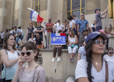 People attend a demonstration in Paris against the COVID-19 pass which grants vaccinated individuals greater ease of access to venues.