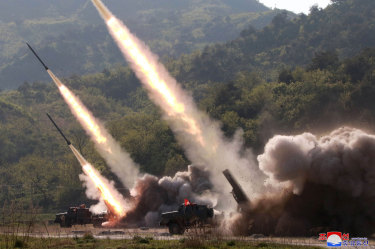 North Korea fired two suspected short-range missiles toward the sea on Thursday, South Korean officials said.