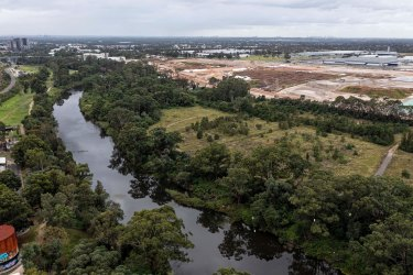 The Moorebank Intermodal project is being developed about 27 kilometres from Sydney's CDB (seen in the distance). The former Defence land has PFAS and other toxic materials requiring long-term management.