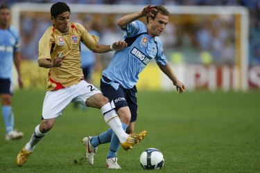 Ali Abbas tackles Sydney FC's Adam Casey during his first spell with the Jets in 2009.