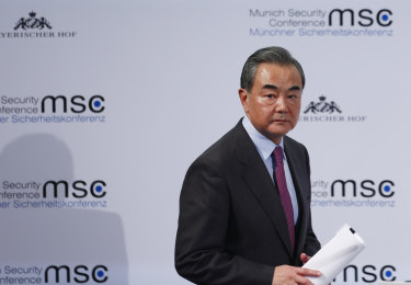 Wang Yi, China's foreign minister, leaves the stage during the Munich Security Conference.