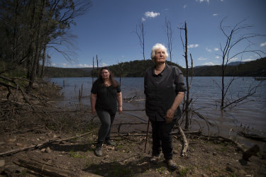 Gundungurra traditional owners, Kazan Brown (left) and Aunty Sharyn Halls, visit an area on the shores of Lake Burragorang that will be inundated if the dam wall is raised.