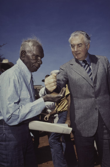 Prime Minister Gough Whitlam pours soil into the  hand of traditional landowner Vincent Lingiari, Northern Territoryin 1975.