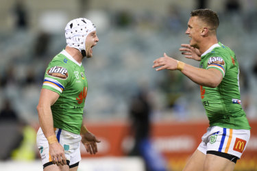 Man of the moment: Jarrod Croker, left, celebrates with Jack Wighton after  Wighton laid on his record-equalling try.