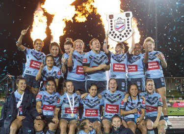 That's one: NSW celebrate their victory in the inaugural Women's State of Origin match.