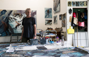 Artist Euan Macleod in his backyard studio.