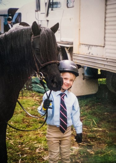 Olivia Inglis at age five, with her first pony.