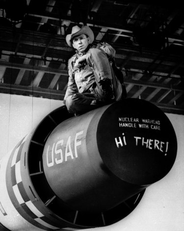 "Actor Slim Pickens playing Major Kong sits atop a nuclear weapon in ""Dr Strangelove"""
