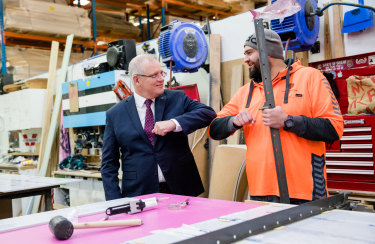 Scott Morrison talked up government's program at a Sydney business in July.