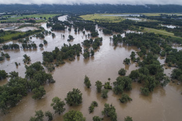 The swollen Nepean River near North Penrith on Tuesday. Concerns about what quality have prompted authorities to ramp up production from Sydney's desalination plant.