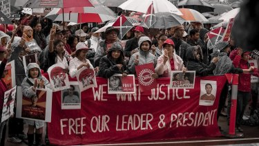 Hundreds protested the Myanmar miltary coup with placards urging the southeastern nation's president be released.