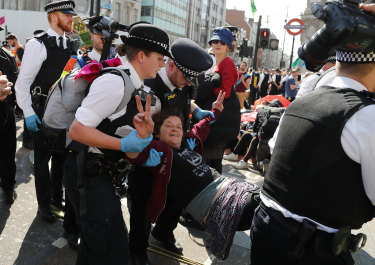 Police arrest protestors at Oxford Circus in London.