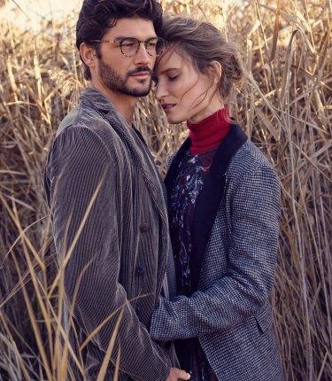 "Johanna wears Zara jacket, $159. Zimmermann ""Paradiso Floating"" dress, $1100. Max Mara ""Persia"" sweater, $770. Emmett wears Giorgio Armani jacket, $3000, sweater, $2200, and trousers, $1600."
