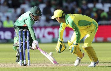 Bangladesh's Mushfiqur Rahim runs to make it to the crease to avoid a run-out.