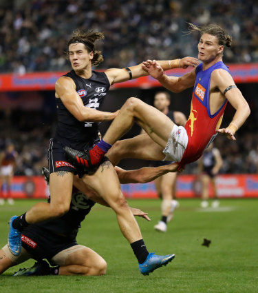 Bump and grind: Lion Eric Hipwood is tackled.