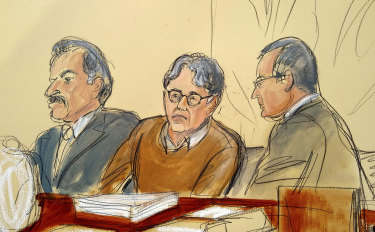 Defendant Keith Raniere, centre, leader of the secretive group NXIVM, in court.
