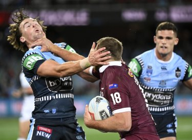 Don't argue: Kurt Capewell fends Clint Gutherson before setting up Queensland's first try.