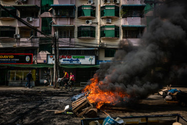 Tyres are set alight by anti-coup protesters at a blockade in Yangon.