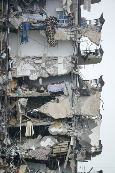 A number of homes in the still-standing part of the apartment building were left exposed.