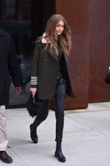 Gigi Hadid does a simple khaki coat with dark denim.
