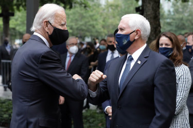Joe Biden and Mike Pence bump arms at the 9/11 memorial in New York.