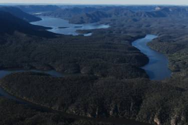 Lake Burragorang from above. The lake sits behind Warragamba Dam, and would potentially fill as much as 17 metres higher if the government proceeds with plans to raise the dam's wall height. A survey found 334 Indigenous sites in the new flood zone during a study that examined only 27 per cent of the at-risk area.