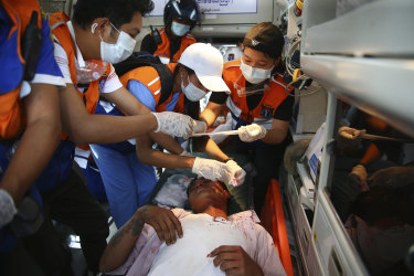 Paramedics tend to a protester injured during a demonstration.