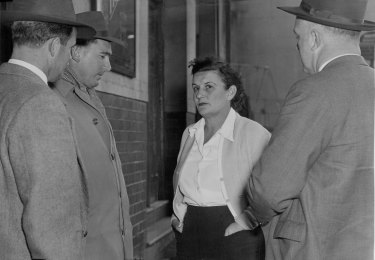 """""""Mrs. J. Thorn, Manageress of the Australian Hotel, being interviewed by homicide detectives at the scene of last night's shooting. June 9, 1956."""""""