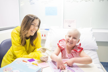 Kylie Estreich, child life therapist at Sydney Children's Hospital, with Ruby Atkinson.