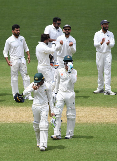 Pumped: Virat Kohli shows his delight at Usman Khawaja's dismissal.