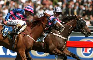 Might and Power, with Jim Cassidy aboard, edges Doriemus in the thrilling 1997 Melbourne Cup.