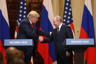 US President Donald Trump shakes hands with Vladimir Putin, Russia's President, during a news conference in Helsinki, Finland, in 2018.