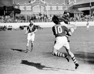 Yugoslav goalkeeper Vladimir Beara makes a save in front of Australia's Harry Robertson during the Yugoslavia vs Australia soccer 'Test' match at the Sydney Showground on 10 September 1949.