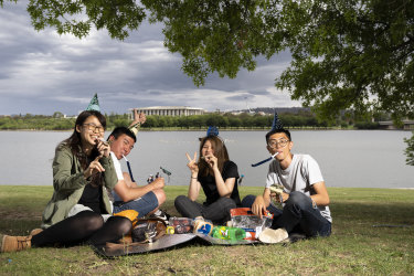 Mona Liu, Yu Li, Lou Liou and Jerry Wu, pictured above at Commonwealth Park, are ready to celebrate New Years Eve
