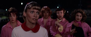 Olivia Newton John with the Pink Ladies of Grease.